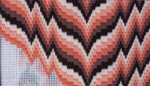 Voorbeeld van Bargello borduurwerk in geschakeerde kleuren.